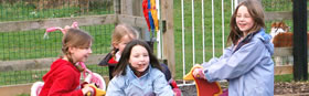 Children playing on play equipment in Lilliput Park